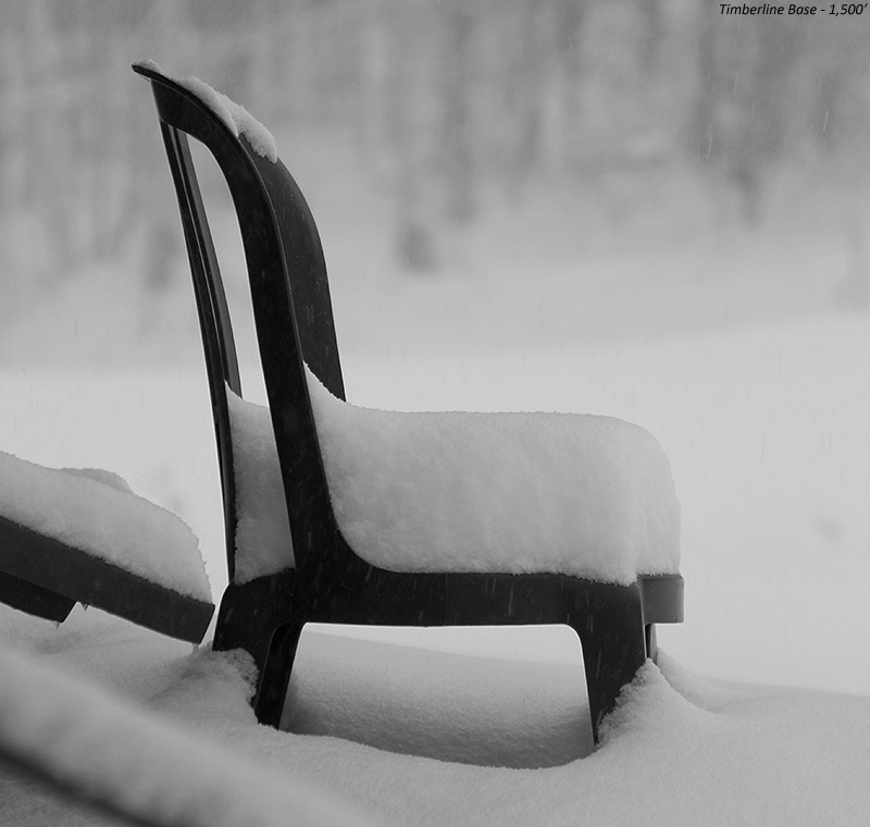 An image of snow from Winter Storm Dylan collecting on a chair by the Timberline Base Lodge at Bolton Valley Ski Resort in Vermont