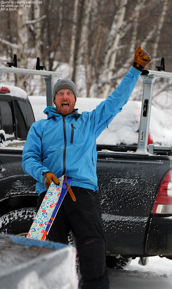 An image of Quinn preparing his skis with climbing skins for a ski tour during Winter Storm Dylan at Bolton Valley Ski Resort in Vermont