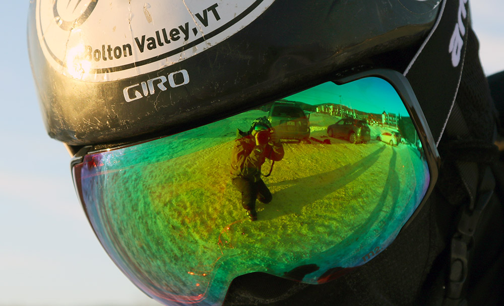 An image of Ty's Anon M2 ski goggles with the photographer Jay in the reflection at Bolton Valley Ski Resort in Vermont