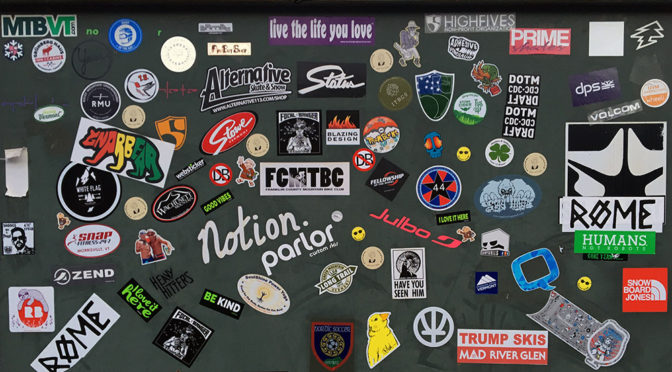 An image of various stickers outside the Piecasso restaurant in Stowe Vermont