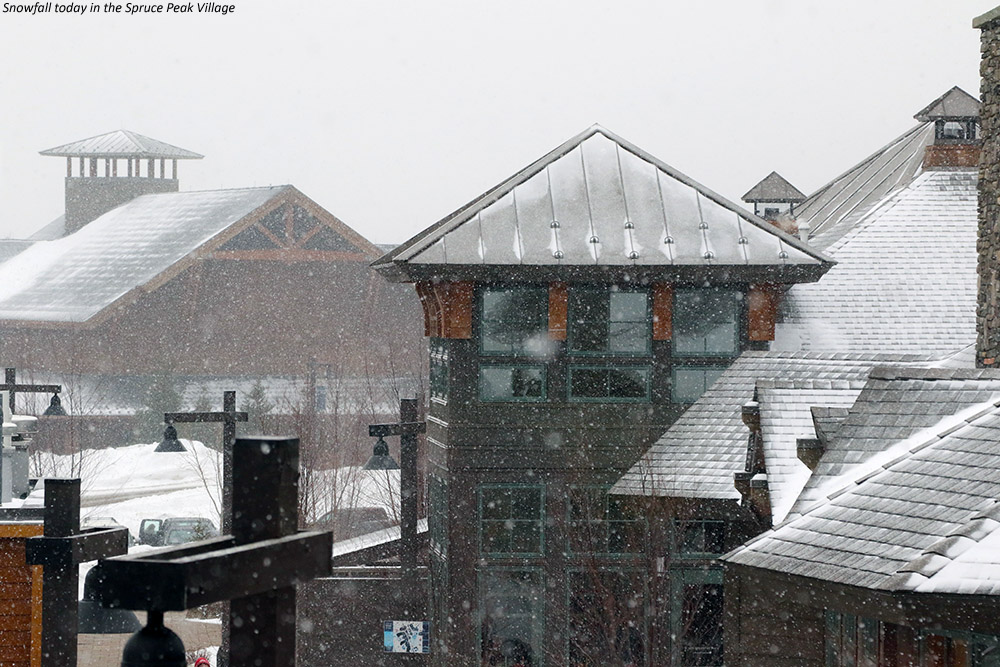 An image of snow falling in the Spruce Peak Village at Stowe Mountain Resort in Vermont