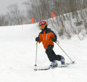 An image of Dylan making a Telemark turn at Stowe Mountain Ski Resort in Vermont