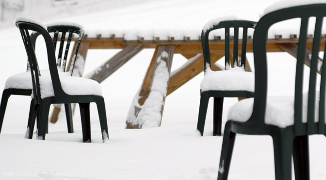 An image of chairs with snow on them outside the Timberline Base Lodge at Bolton Valley Ski Resort in Vermont