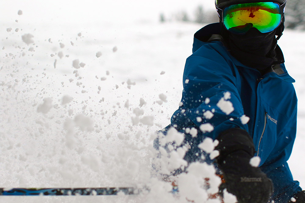 An image of Ty spraying powder while skiing at Bolton Valley Resort in Vermont