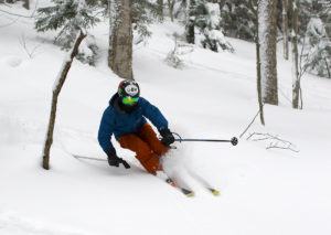 An image of Ty skiing powder in the Villager Trees at Bolton Valley Resort in Vermont