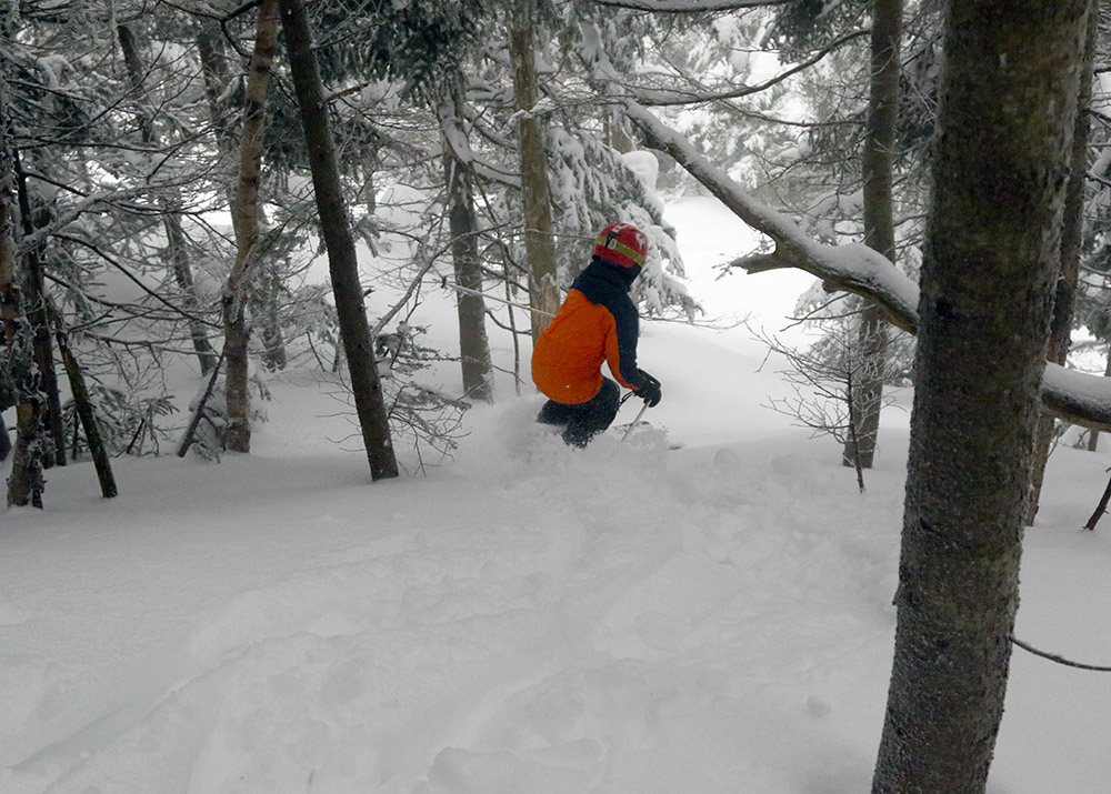 An image of Dylan skiing the trees of the Green Acres area of Stowe Mountain Resort in Vermont