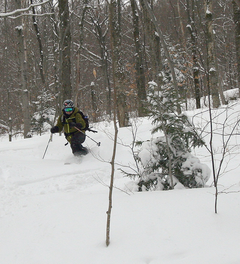 An image of Jay skiing powder in the backcountry near Bolton Valley Ski Resort in Vermont
