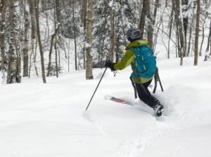 An image of Erica skiing in the backcountry area of Bolton Valley Ski Resort in Vermont