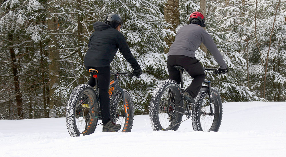 An image of people riding fat bikes on the Nordic Trails at Bolton Valley Resort in Vermont March after a fresh snowfall