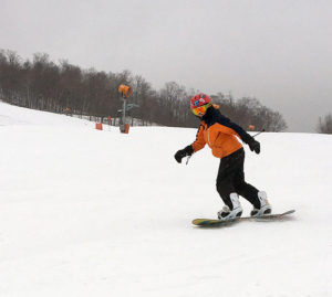 An image of Dylan snowboard in the Meadows are at Stowe Mountain Resort in Vermont