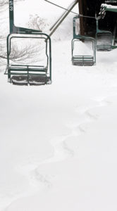 An image of a snowboard track in powder snow at Bolton Valley Ski Resort in Vermont after Winter Storm Quinn