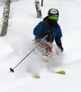 An image of Ty skiing powder in the Villager Trees area of Bolton Valley Resort in Vermont