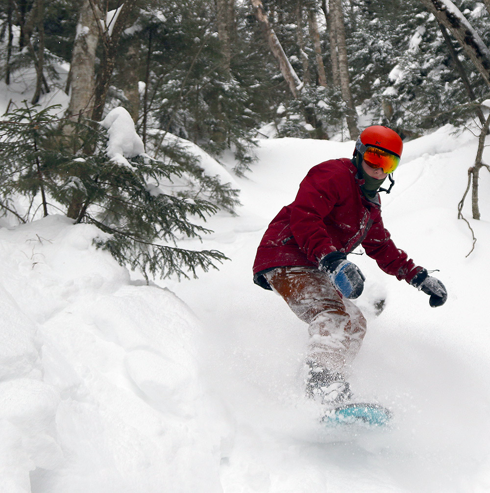An image of Robbie snowboarding at Stowe Mountain Resort in Vermont