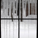 An image out the window of the Bryant Cabin showing icicles in the backcountry near Bolton Valley Ski Resort in Vermont