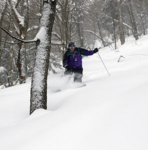 An image of Stephen skiing powder in the backcountry near Bolton Valley Ski Resort in Vermont