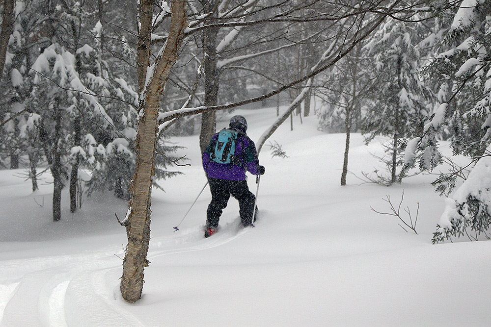 An image of Stephen dropping off Heavenly Highway into some powder on the backcountry network at Bolton Valley Resort in Vermont