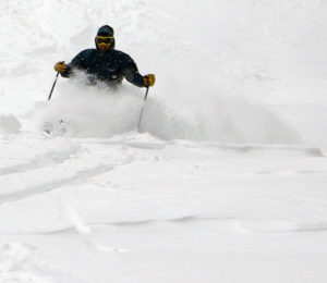 An image of Dave skiing powder on the Spell Binder trail at Bolton Valley Resort in Vermont