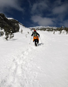An image of Dylan ascending the Climbing Gully in Mt. Mansfield's alpine terrain above Stowe Mountain Resort in Vermont