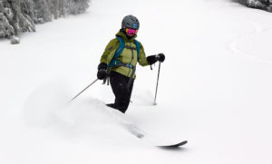 An image of Erica skiing powder near the Vista Summit at Bolton Valley Ski Resort in Vermont