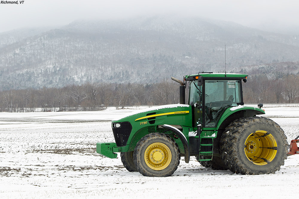 An image of a tractor with snow in Richmond Vermont after an April snowstorm
