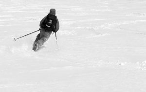 An image of Ty skiing some fresh snow in late April on the Nosedive trail at Stowe Mountain Resort in Vermont