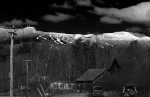An image of Mt. Mansfield in Vermont with fresh snow on a sunny day in April