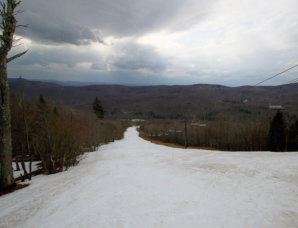 An image of the Showtime trail in the Timberline area of Bolton Valley Ski Resort in Vermont in late April