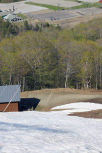 An image looking down at some of the snow on the Liftline trail at Stowe Mountain Resort in Vermont in late May