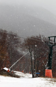 An image the Crossover trail and mountains in the background at Stowe Mountain Resort during an October snowstorm