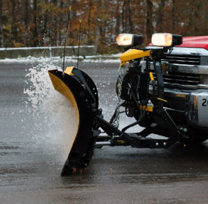 An image of a plow spraying some very slushy snow at Stowe Mountain Resort in Vermont after an October nor'easter snowstorm