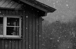 An image of the Mansfield Base Lodge at Stowe Mountain Resort in Vermont with snowfall during an October storm