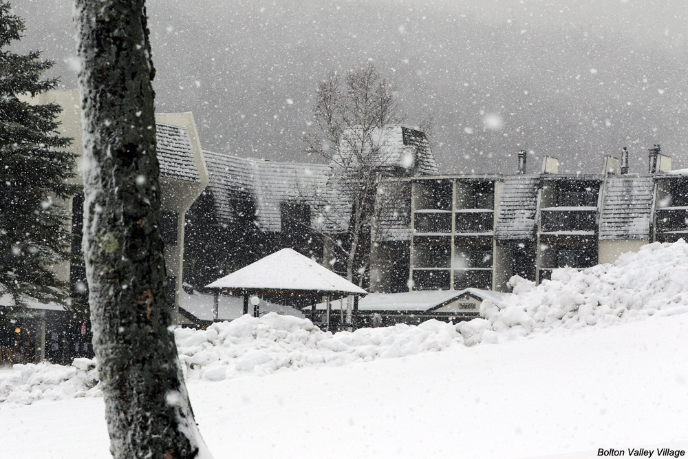 An image of November snow in the Bolton Valley Village at Bolton Valley Ski Resort in Vermont