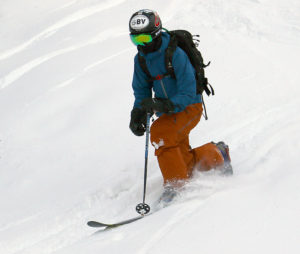An image of Ty Telemark skiing in powder after a November snowstorm at Bolton Valley Resort in Vermont