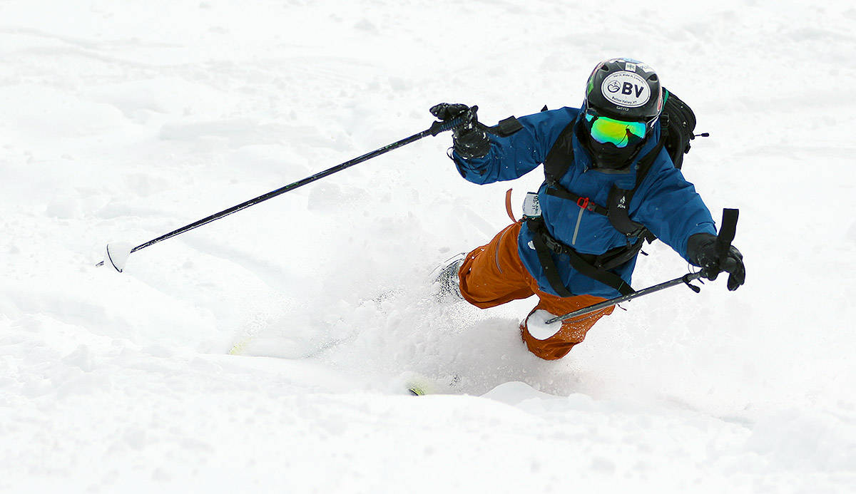 An image of Ty falling in the powder while on a ski tour at Bolton Valley Resort in Vermont