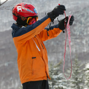 An image of Dylan getting ready to pack up his climbing skins during a November ski tour at Bolton Valley Resort in Vermont