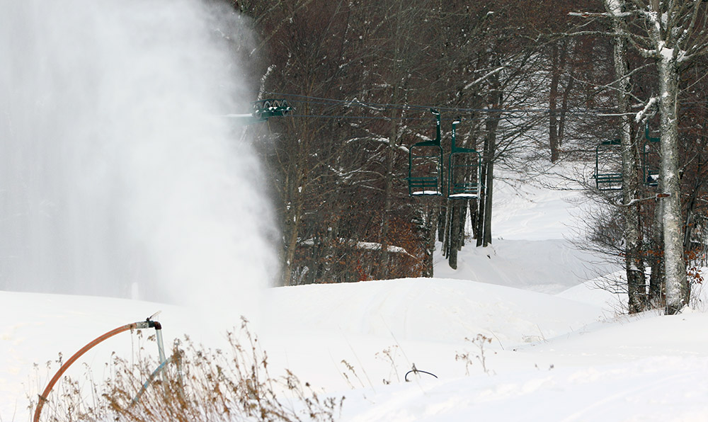 An image of a snow gun making snow in mid November at Bolton Valley Ski Resort in Vermont