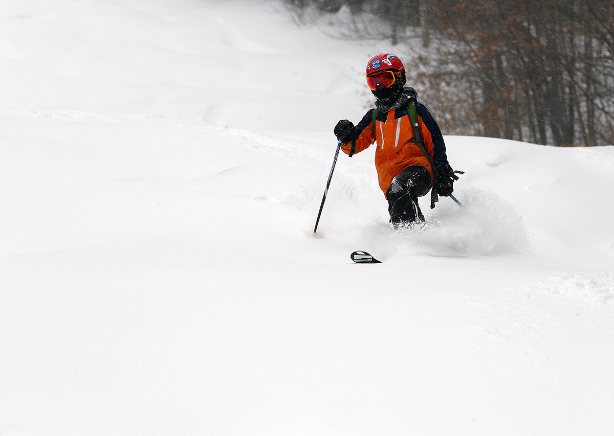 An image of Dylan skiing powder after a snow squall at Bolton Valley Resort in Vermont