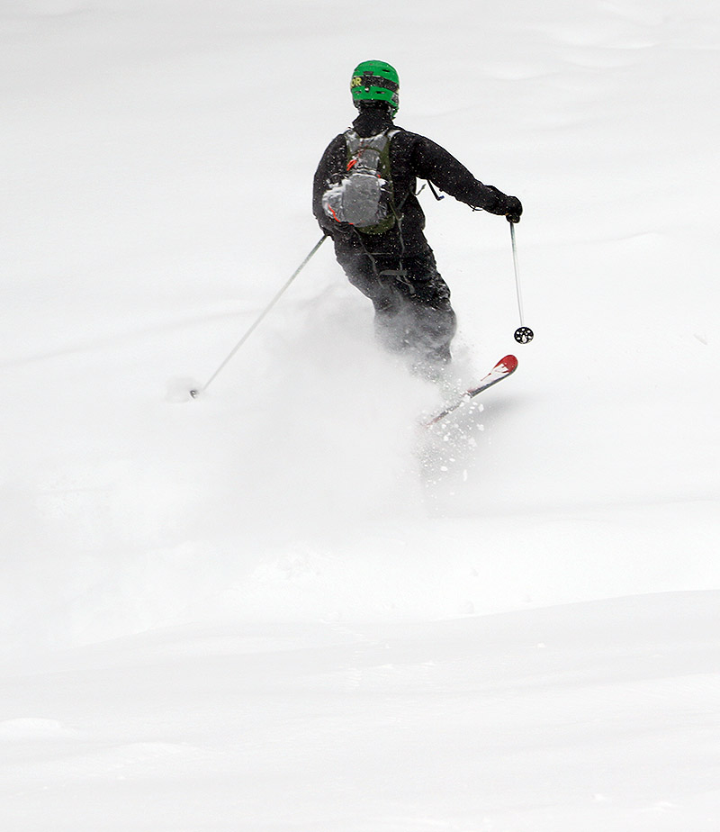 An image of Johannes jumping a water bar during a ski tour at Bolton Valley Resort in Vermont