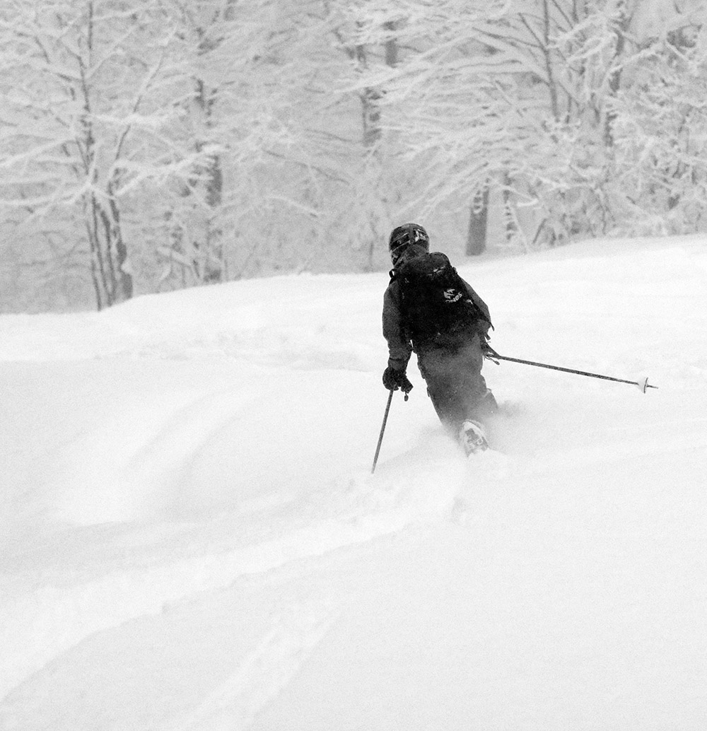 An image of Ty Telemark skiing in 18 to 20 inches of fresh powder from Winter Storm Bruce at Bolton Valley Resort in Vermont