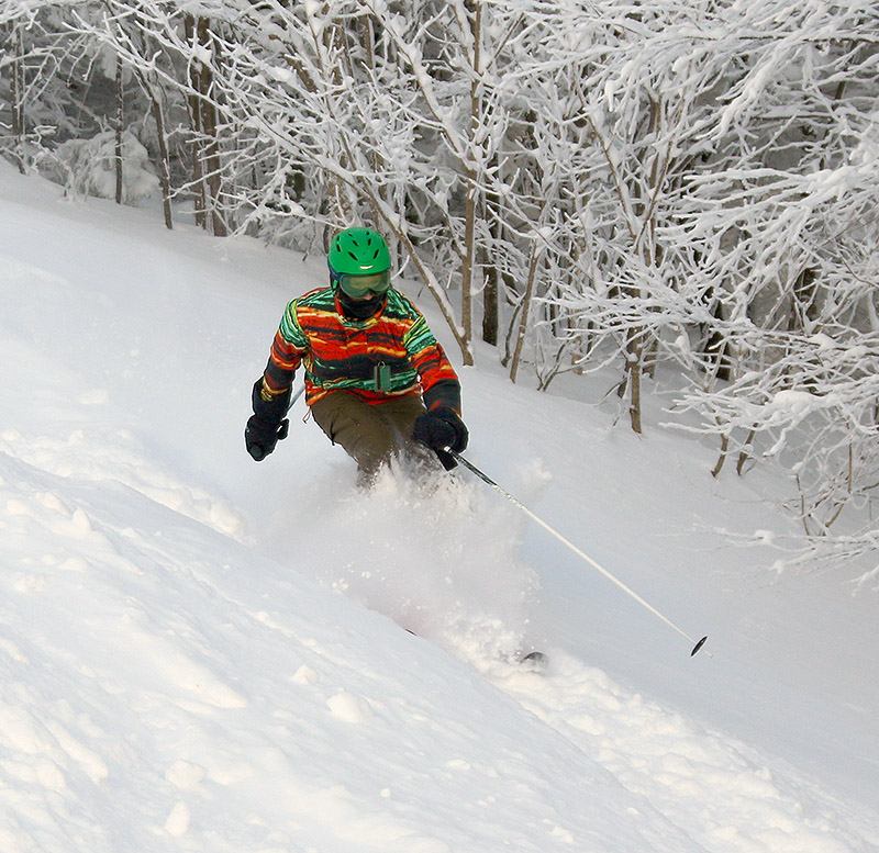 An image of Johannes skiing powder in the Wilderness area at Bolton Valley Resort in Vermont