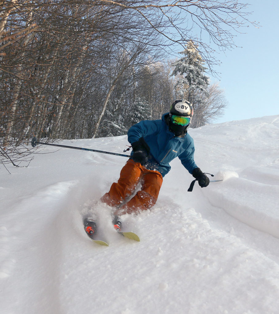 An image of Ty skiing powder on the Valley Road trail at Bolton Valley Resort in Vermont