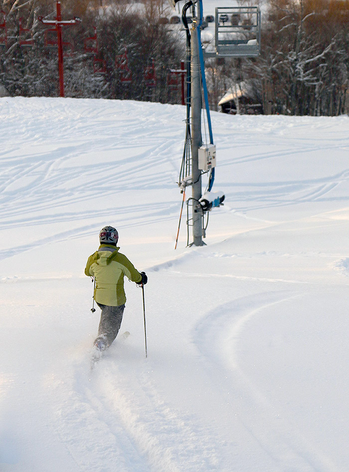 An image of Erica skiing powder on the Valley Road trail at Bolton Valley Resort in Vermont