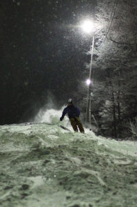An image of Ty night skiing on the Beech Seal trail at Bolton Valley Resort in Vermont