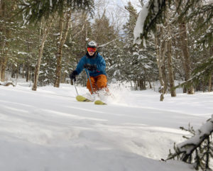 An image of Ty skiing powder in White Rabbit area of Bolton Valley Resort in Vermont