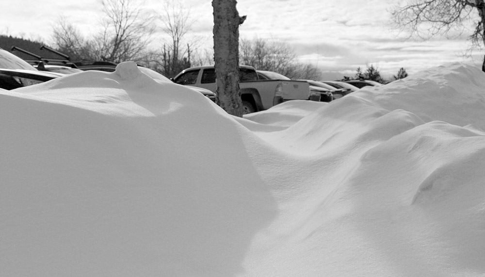 An image of snow banks in the parking lots near the village at Bolton Valley Ski Resort in Vermont
