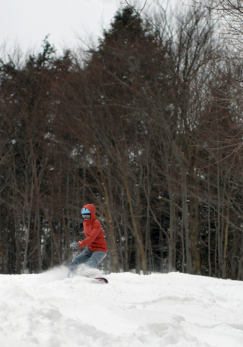 An image of Molly snowboarding on the Upper Meadows trail at Stowe Mountain Resort in Vermont
