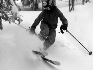 An image of Ty skiing powder in the trees at Bolton Valley Ski Resort in Vermont