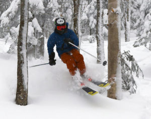 An image of Ty skiing powder snow in the trees at Bolton Valley Ski Resort in Vermont