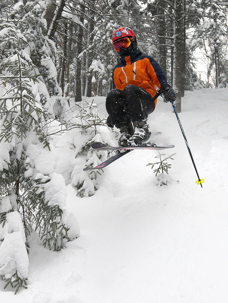 An image of Dylan jumping on his skis in the Thundergoat Pass area at Bolton Valley Ski Resort in Vermont