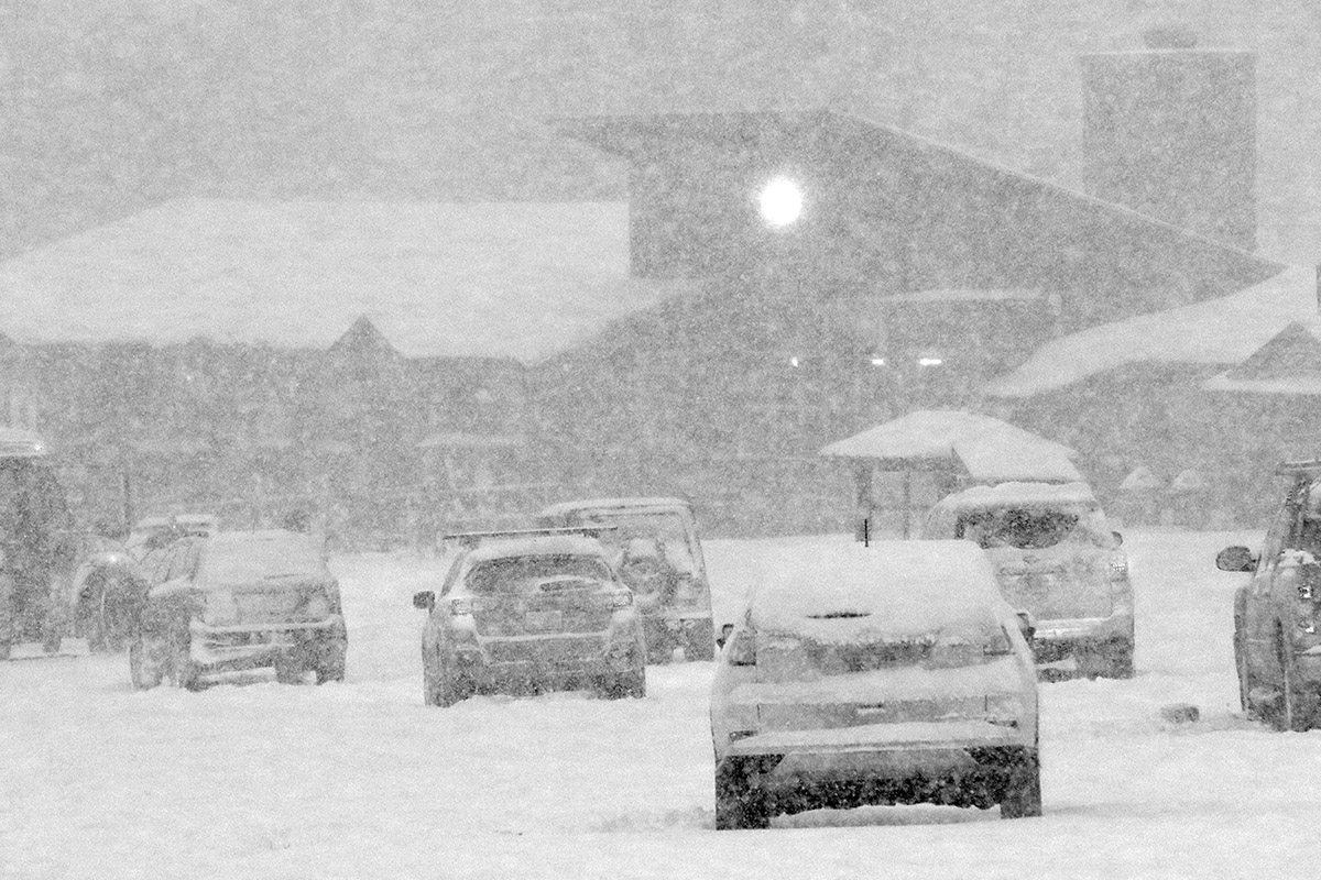 An image showing very heavy snowfall in the Mansfield parking lot at Stowe Mountain Resort in Vermont
